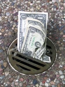 ist2_241226-money-down-the-drain-4