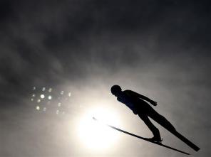 Pavel Churavy – Atlet Asal Repbulik Ceko Sedang Beraksi Pada Pertandingan Nordic Combined Men's Team. (Sumber : http://www.sochi2014.com/en/photos)